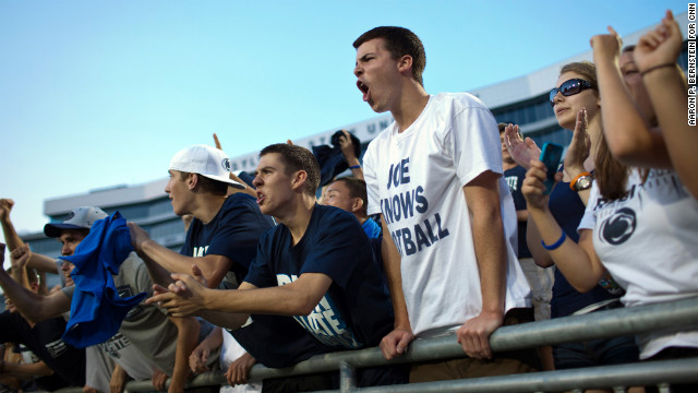 Penn State football fans cheer during the Football Eve pep rally at Beaver Stadium.
