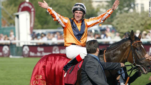  Andrasch Starke celebrates on Danedream after winning the 2011 Prix De LArc De Triomphe at Longchamps.