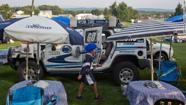Penn State fan Saya Melo walks through his famiy's tailgating area outside the stadium.