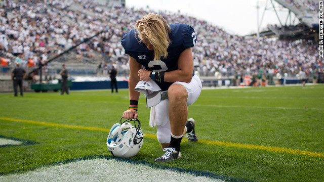 Penn State's Shane McGregor kneels in prayer following the Nittany Lions' loss to Ohio University at Beaver Stadium in State College, Pennsylvania, on Saturday, September 1. The final score was 24-14.