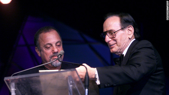 "Hal David presents the Johnny Mercer Award to Billy Joel in New York City on June 14, 2001. David wrote hit songs such as ""Raindrops Keep Falling on my Head,"" ""This Guy's in Love With You,"" ""I'll Never Fall in Love Again,"" and ""What The World Needs Now is Love."" He was chairman emeritus of the Songwriters Hall of Fame. He died at 91."