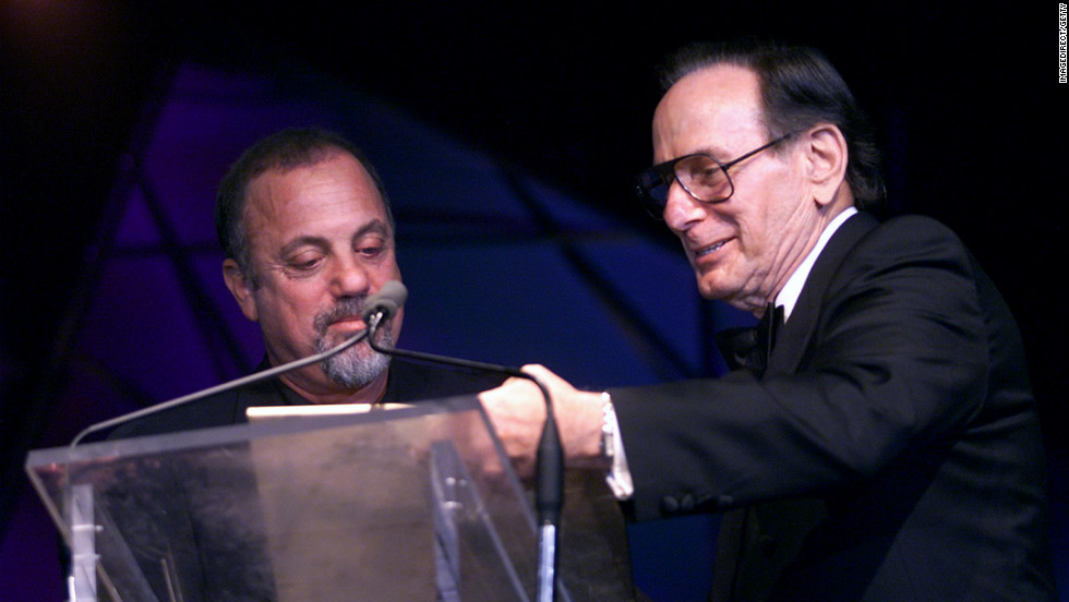 Hal David presents the Johnny Mercer Award to Billy Joel in New York City on June 14, 2001. David wrote hit songs such as &quot;Raindrops Keep Falling on my Head,&quot; &quot;This Guy's in Love With You,&quot; &quot;I'll Never Fall in Love Again,&quot; and &quot;What The World Needs Now is Love.&quot; He was chairman emeritus of the Songwriters Hall of Fame. He died at 91.