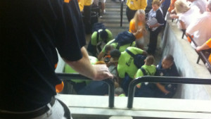 Medical personnel tend to Isaac Grubb after his fall.