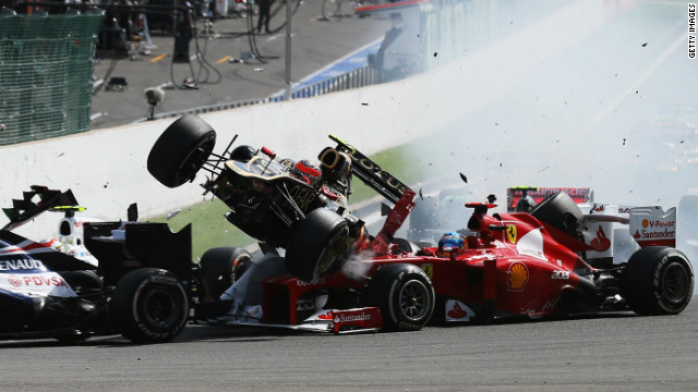 Grosjean's Lotus is about to fly over the red Ferrari of championship leader Fernando Alonso.