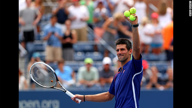 Novak Djokovic of Serbia waves to the crowd Sunday after winning his men's singles third-round match against Julien Benneteau of France.