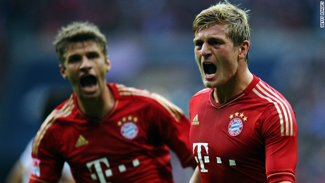 Tony Kroos celebrates scoring Bayern's second goal with help from teammate Thomas Mueller.