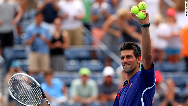 New balls please. Djokovic reacts after his straight sets victory over Julien Benneteau of France.