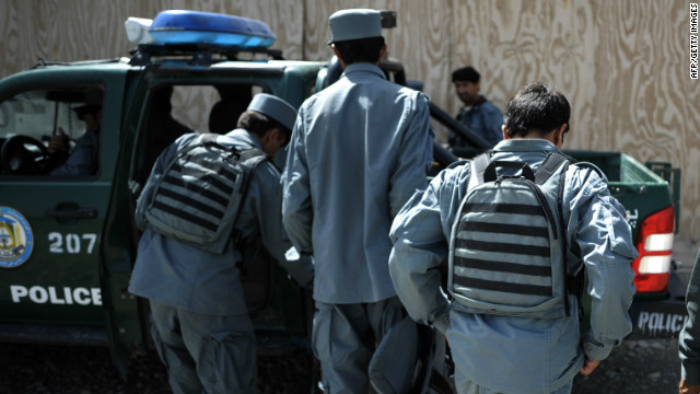 Members of the Afghan Police load a truck following training at Narizah base in Narizah, Khost Province, on August 12, 2012.