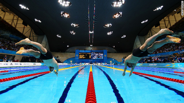 Daniel Fox, left, of Australia and Marc Evers of the Netherlands dive into the pool at the start of the men's 200-meter freestyle - S14 heat 3.