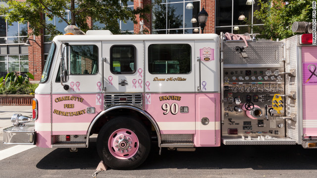 The Engine 90 firetruck, also known as the Pink Lady, parks outside of the convention center Sunday. The reserve truck honors the first woman to serve in the Charlotte Fire Department, who died of breast cancer.