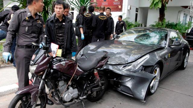 Thai police inspect a Ferrari owned by Vorayuth Yoovidhya, grandson of the creator of Red Bull energy drink.
