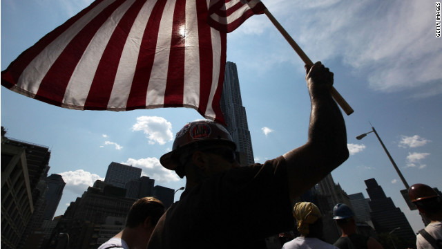 A union worker carries an American flag across the Brooklyn Bridge during a March for the Middle Class In June 2011.