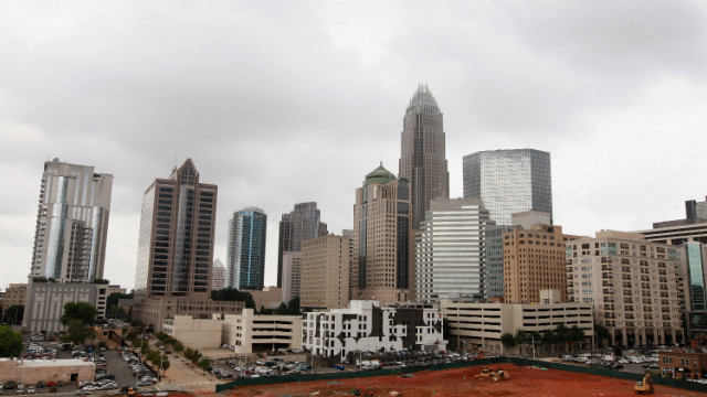 The Bank of America Corporate Center building, which houses the bank's corporate headquarters, rises above the Charlotte skyline. Charlotte is the second largest financial center by assets in the United States, behind New York.