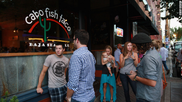 Diners wait to get in at Cabo Fish Taco in Charlotte's NoDa district. Businesses in Charlotte are anticipating a boost in sales when the city hosts the DNC.
