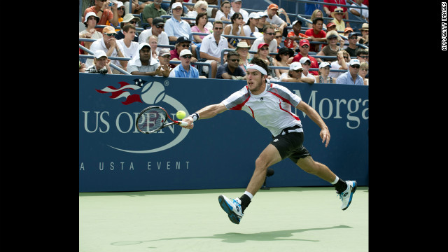 Leonardo Mayer of Argentina hits a return to Juan Martin Del Potro of Argentina during their men's singles third-round match Sunday.