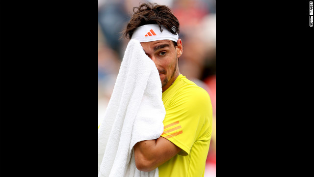 Fognini wipes his face with a towel during his men's singles third-round match against Roddick.