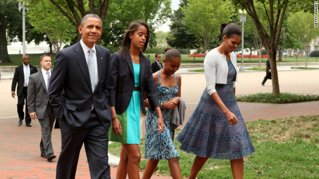 The first family walks across Lafayette Park to St. John's Episcopal Church to attend Sunday services in Washington on August 19, 2012.