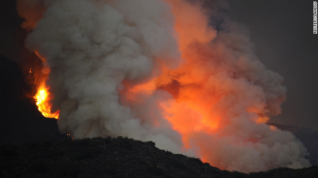 Thick smoke rises Sunday from the hills above the San Gabriel Mountains in the Angeles National Forest near Los Angeles.
