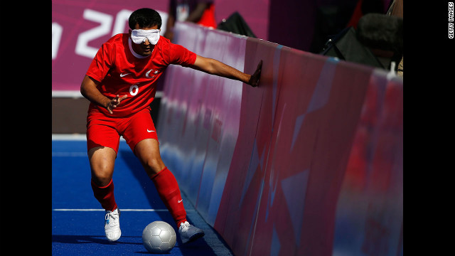 Turkey's Ramazan Kunduz uses the side wall for guidance during the men's team football 5-a-side B1 preliminary match Tuesday.