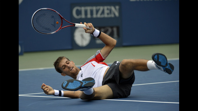 Martin Klizan of Slovakia takes a tumble Monday.