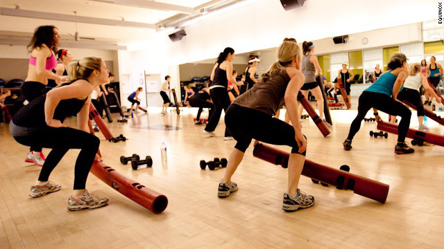 Members at an Equinox gym take a Tabata class. 