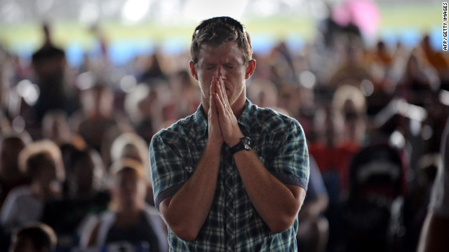 A man prays during a public prayer service at the Verizon Wireless Amphitheatre on Sunday, September 2, ahead of the convention.