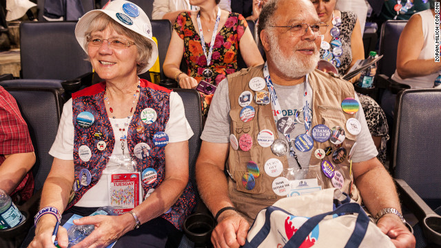 Gene Finley from Washington and Elizabeth Campbell from Washington make custom hand made buttons for themselves on Tuesday.