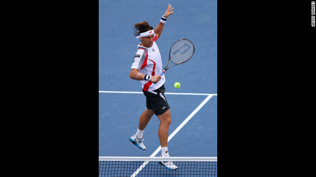 David Ferrer of Spain returns a shot against Richard Gasquet of France during their men's singles fourth-round match on Tuesday.