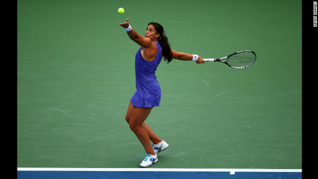 Marion Bartoli of France serves against Maria Sharapova of Russia on Tuesday.