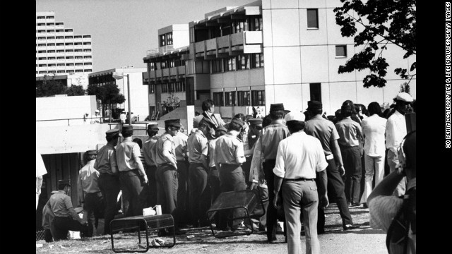 With terrorists holed up in the Israeli athletes' quarters, swarms of German policemen, in uniform and plain clothes, move in and seal off the area, Munich, September 1972.