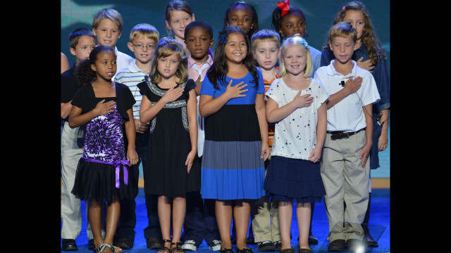 The third-grade class from W.R. O'Dell Elementary School in Concord, North Carolina, recites the Pledge of Allegiance.