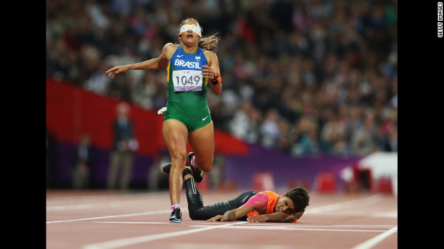 Brazilian Terezinha Guilhermina loses her guide Guilherme Soares de Santana after he fell in the Women's 400-meter T12 final at the 2012 London Paralympic Games on Tuesday, September 4.