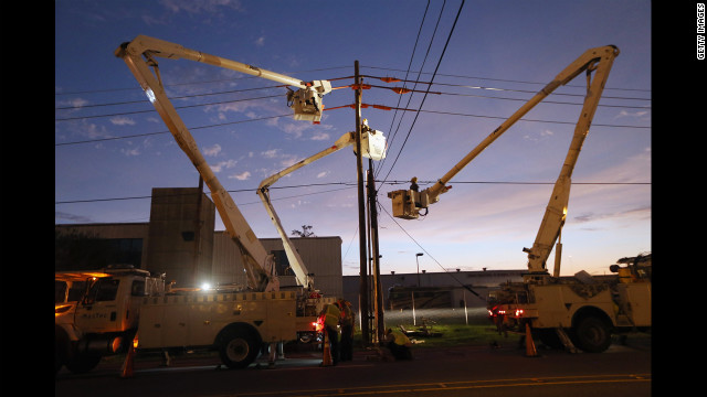 Utility crews work to restore electricity Tuesday in Harvey, Louisiana.