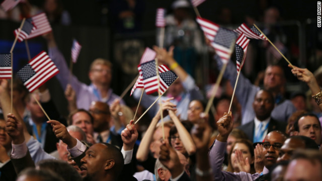 Audience members wave American flags Tuesday.