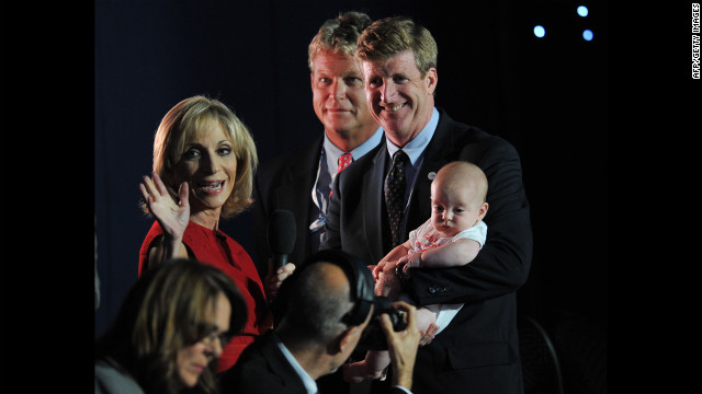 Former Rep. Patrick Kennedy holds his child as he speaks to the media Tuesday. He is a son of the late Sen. Ted Kennedy.