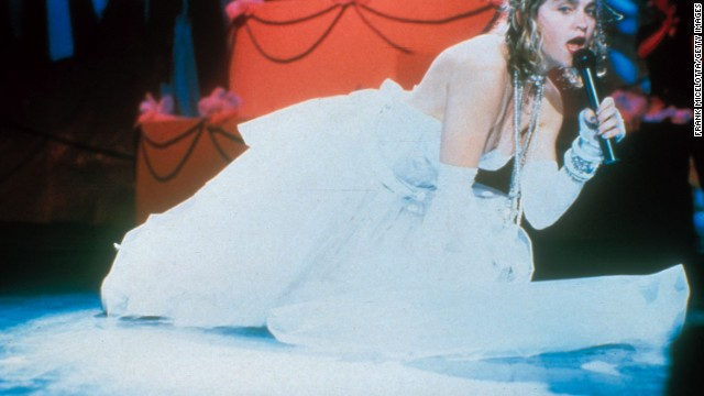 "Dressed in a revealing wedding dress, lace gloves and her infamous ""boy toy"" belt, Madonna performed ""Like a Virgin"" at the first Video Music Awards in 1984. Her album of the same name, which dropped that November, went on to become one of the best-selling albums of all time."