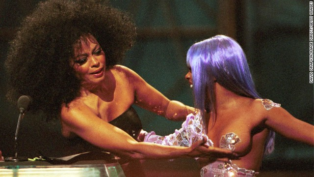 Lil' Kim wore a purple wig and pantsuit to the 1999 VMAs. Revealing her left breast, which was covered by a matching pasty, the getup gave a whole new meaning to off the shoulder. Diana Ross fondled Lil' Kim's exposed lady part during the show, and we've never been able to forget it.
