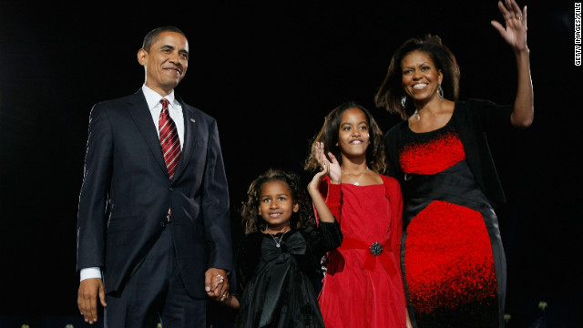 President-elect Obama stands on a stage with the future-first family during an election night gathering in Grant Park on November 4, 2008, in Chicago.