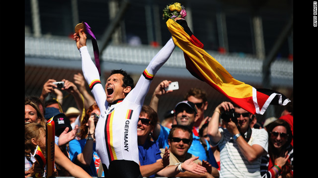 Michael Teuber of Germany celebrates winning the men's individual C 1 time trial on Wednesday.