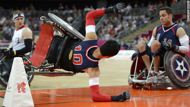 Will Groulx, center, of the United States gets upended by Britain's Aaron Phipps, left, during the rugby match on Wednesday.