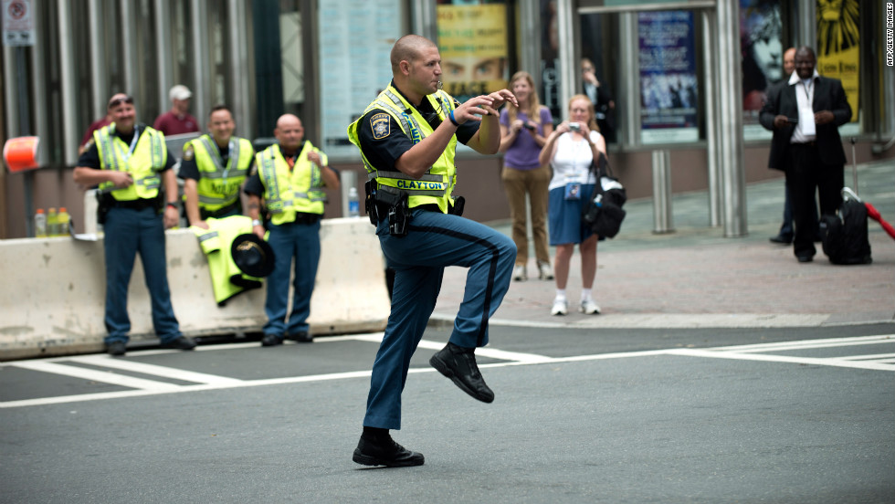 A sheriff's deputy puts a bit of creativity into directing traffic as people arrive for the second day of the 2012 Democratic National Convention in Charlotte, North Carolina.