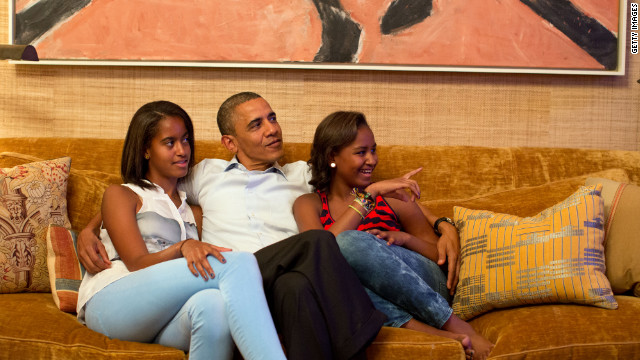 President Barack Obama and his daughters, Malia, left, and Sasha, watch on television as first lady Michelle Obama delivers her speech at the DNC from the Treaty Room in the White House on September 4, 2012.