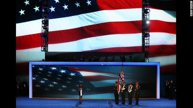Olympic gymnast Gabby Douglas leads the Pledge of Allegiance as the West Charlotte High School ROTC presents the colors on Wednesday.