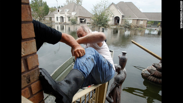 Fred Leslie is helped into a boat after retrieving items from his home, which flooded during Hurricane Isaac on September 5, 2012, in the Braithwaite neighborhood of New Orleans. Hurricane Isaac caused an estimated $2.3 billion in damage.