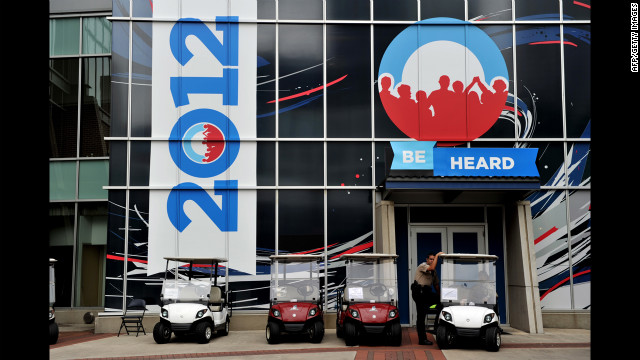 A police officer stands near golf carts outside the Time Warner Cable Arena on Wednesday.
