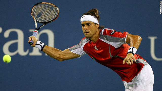 David Ferrer of Spain returns a shot against Richard Gasquet during their fourth-round match on day nine of the 2012 U.S. Open.