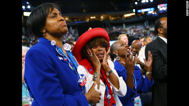 A woman reacts as Missouri Rep. Emanuel Cleaver II, chair of the Congressional Black Caucus, speaks on Wednesday.