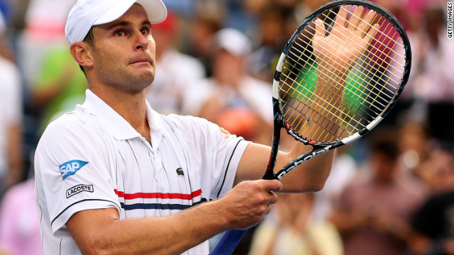 Andy Roddick of the United States salutes the crowd after losing his final career match to Juan Martin del Potro of Argentina in their men's singles fourth-round match at the 2012 U.S. Open on Wednesday, September 5. 