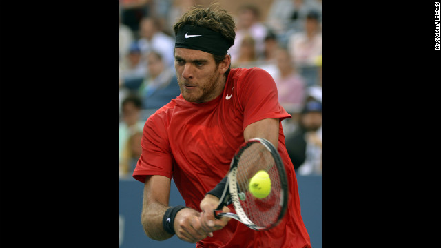 Del Potro plays returns a backhand to Roddick on Wednesday.