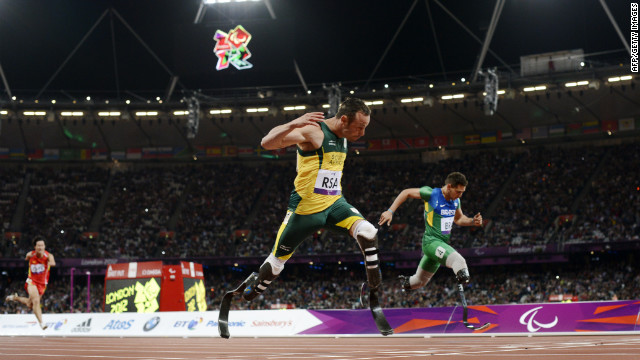 South Africa's Oscar Pistorius lunges toward the finish line ahead of Brazil's Alan Oliveira as he anchors his team to win the men's 4x100-meter relay T42-46 final and set a new world record on Thursday.